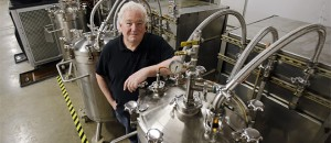 "In this photo taken on Friday, May 29, 2015, Tom Lix, founder and chairman of Cleveland Whiskey Company, stands next to the stainless steel pressure aging tanks used to speed up the whiskey process, in Cleveland. Recently, some distillers have been taking shortcuts, using technology to mimic the effects of long aging - and prompting spirited debate over the merits of the resulting liquors. ""The traditionalists hate us,"" says Lix. ""They're all very interested in what's being done, but of course it runs very contrary to not only generations of how it's been processed, but generations of how it's been talked about. All of the marketing has been around how it takes time and how you have to have patience. I just say age is really irrelevant."" (AP Photo/Tony Dejak)"